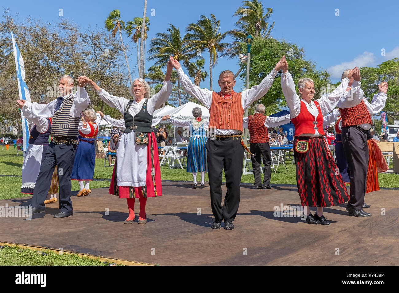 Lake Worth, Florida, USA March 3, 2019, Midnight Sun Festival Celebrating Finnish Culture. The couples form an outer circle holding hands up high. - Stock Image