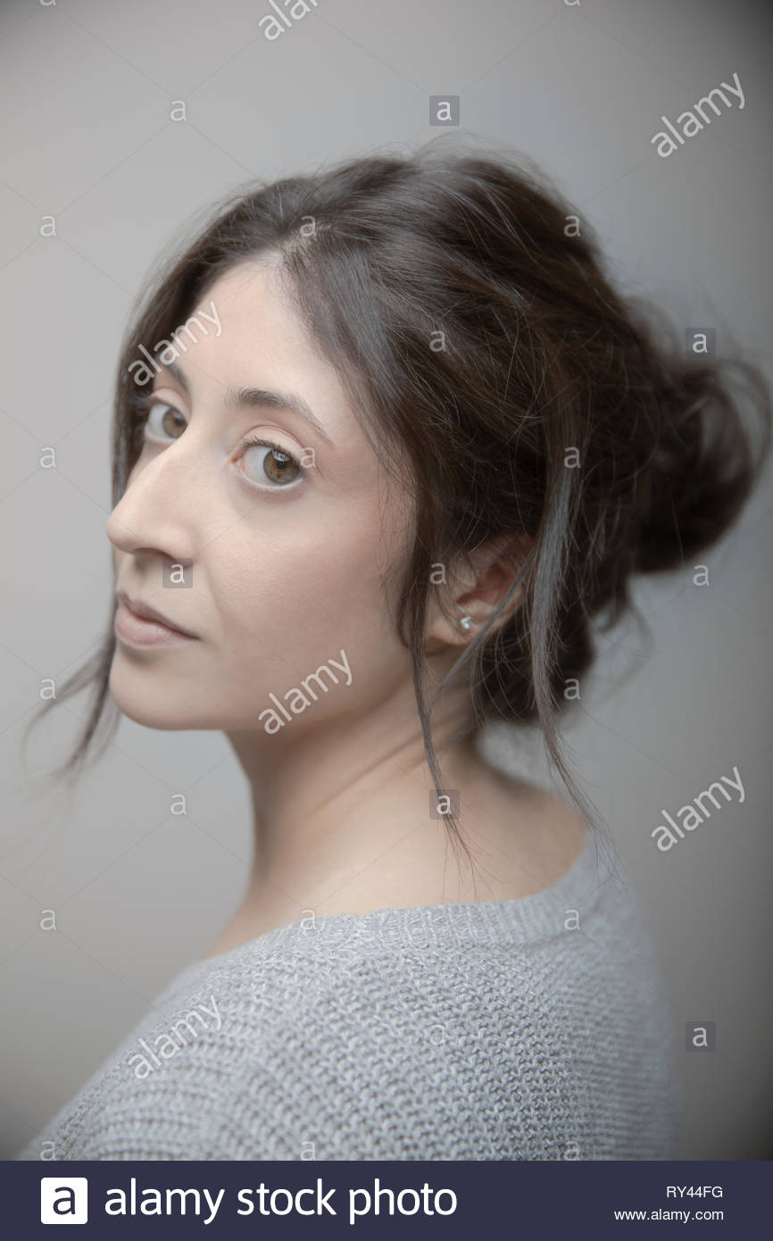 Portrait confident beautiful brunette Latina woman with brown eyes - Stock Image
