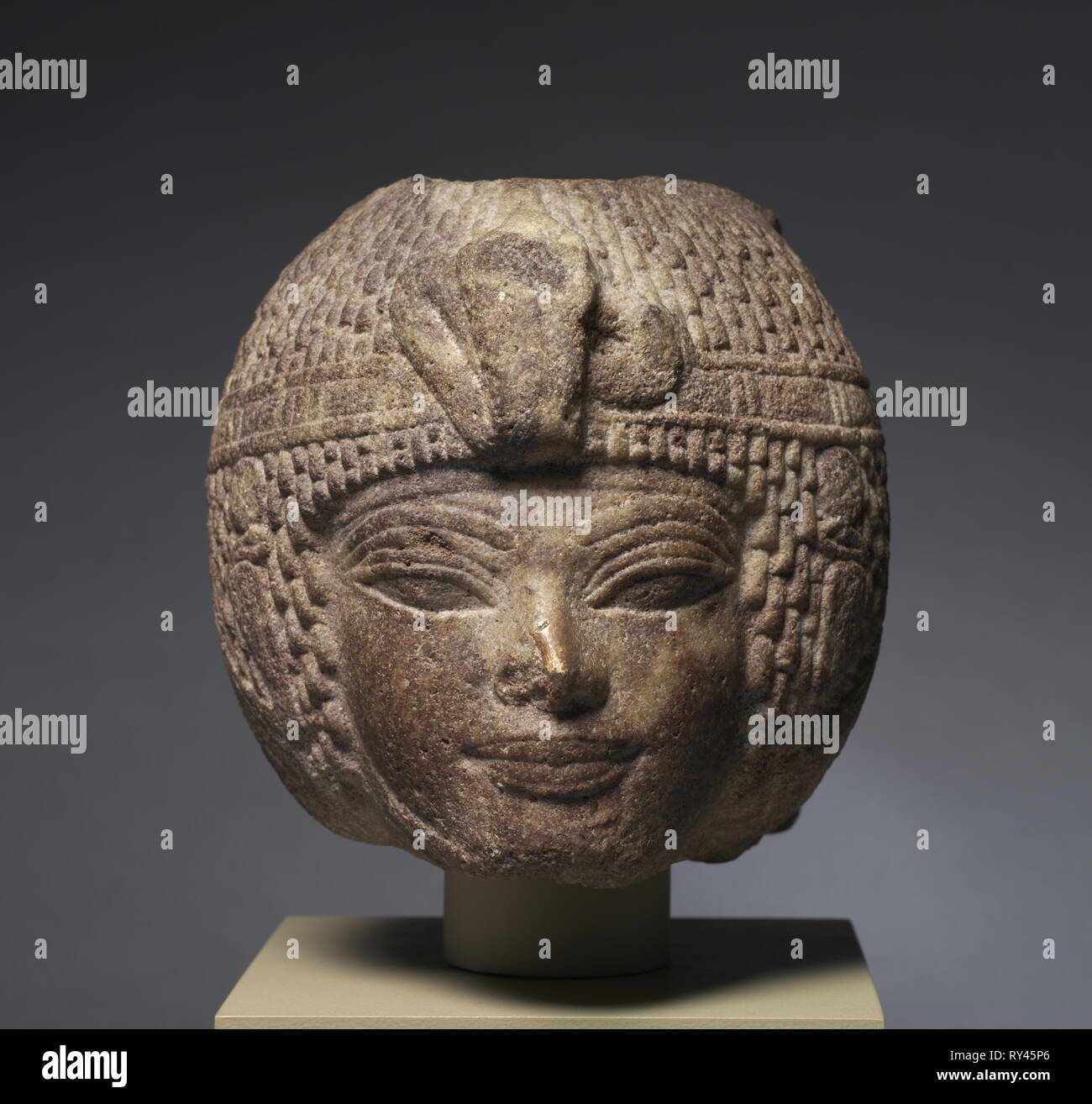 Head of Amenhotep III Wearing the Round Wig, c. 1391-1353 BC. Egypt, New Kingdom, Dynasty 18, reign of Amenhotep III, 1391-1353 BC. Brown quartzite; overall: 17.3 x 17 x 25.3 cm (6 13/16 x 6 11/16 x 9 15/16 in - Stock Image