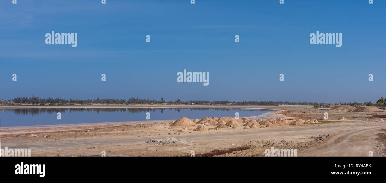 Panoramic view of Lac Rose (meaning Pink Lake).  Lake Retba with the red water is  UNESCO WOrld Heritage. Llies north of the Cap Vert peninsula of Sen Stock Photo