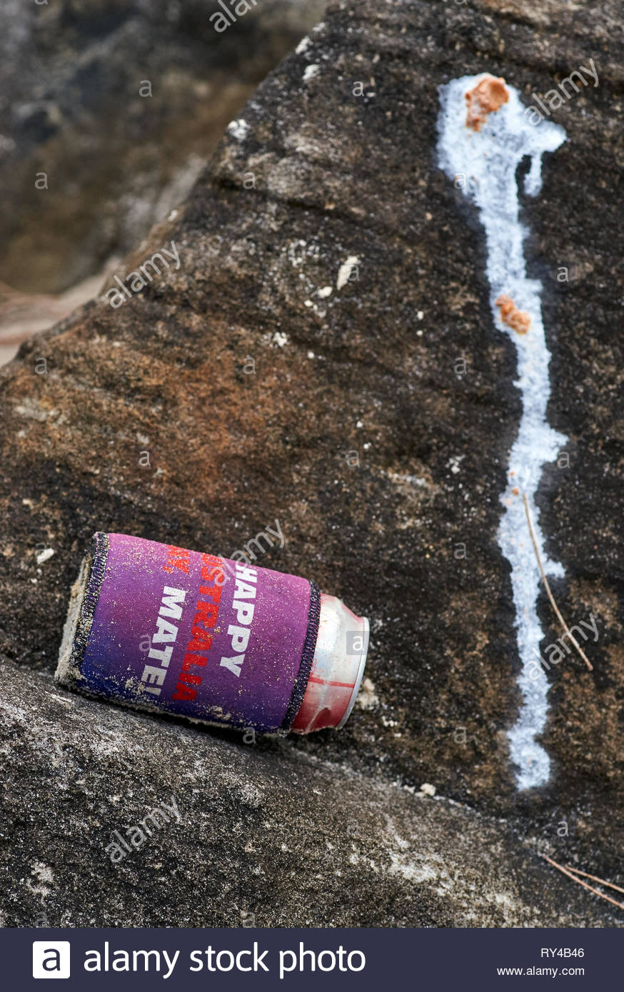 A stubby holder and can, found washed up at the edge of the Clarence River; lies next to bird feces. Writing on it states: 'Happy Australia Day, Mate! - Stock Image