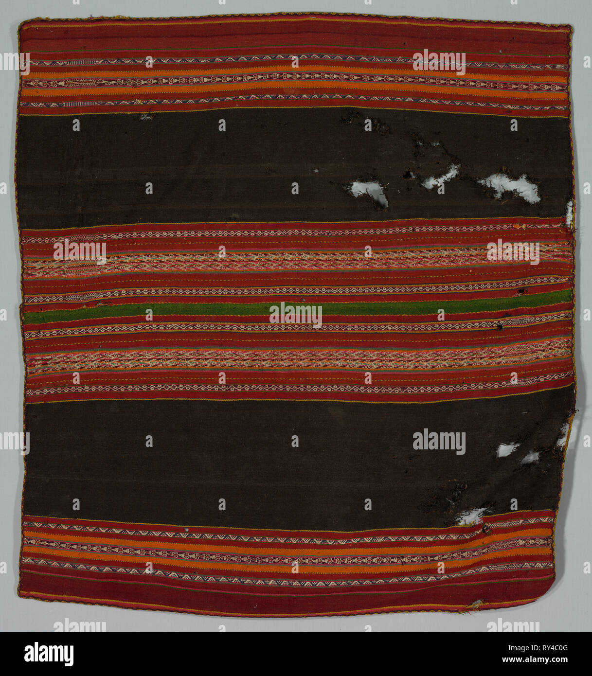 Warp Patterned Cloth, late 1800s. Bolivia, Salinas, late 19th century. Wool; overall: 110.5 x 101.6 cm (43 1/2 x 40 in - Stock Image