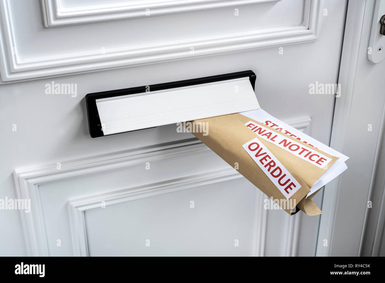 Statement, final notice, overdue, financial problems debt. Final demands delivered through a letterbox. - Stock Image