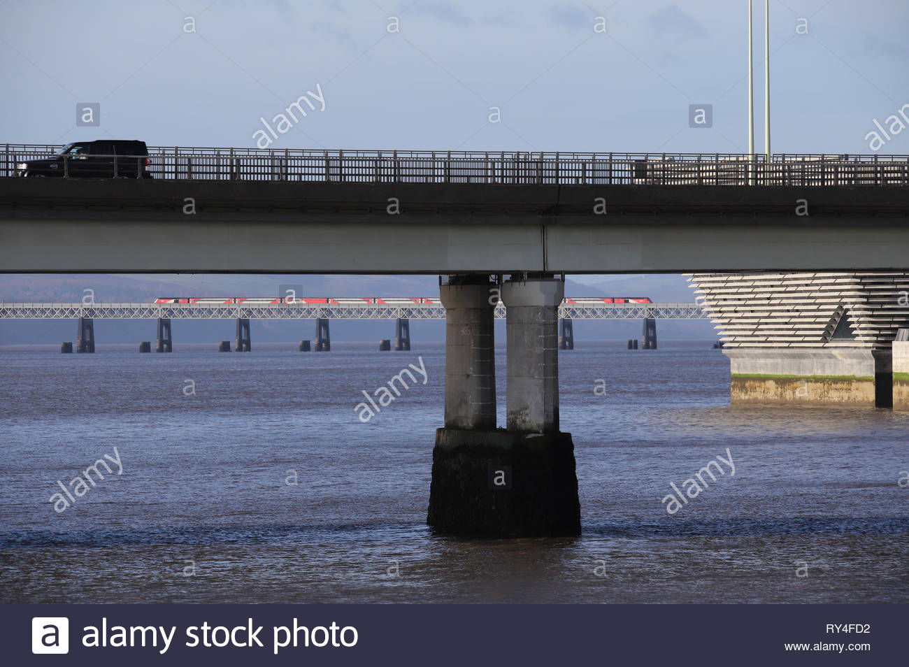 Tay Road Bridge and LNER train crossing Tay Rail Bridge Dundee Scotland  March 2019 Stock Photo