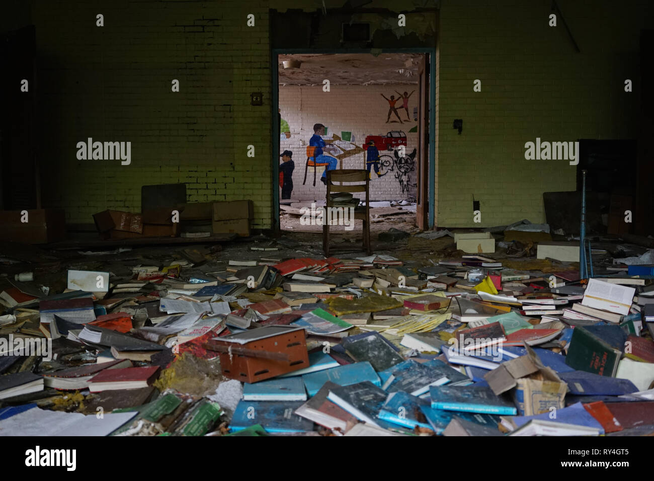 Detroit, Michigan, May 18, 2018: Interior view of abandoned and damaged George Ferris School in Detroit. Like other schools in Highland Park, Ferris - Stock Image