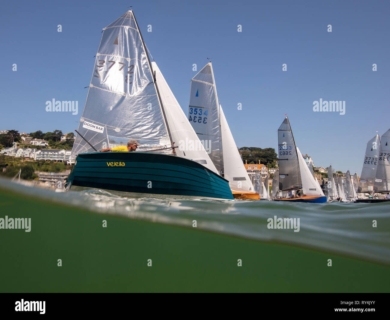Yachts sailing in Salcombe Town Regatta in the summer. - Stock Image