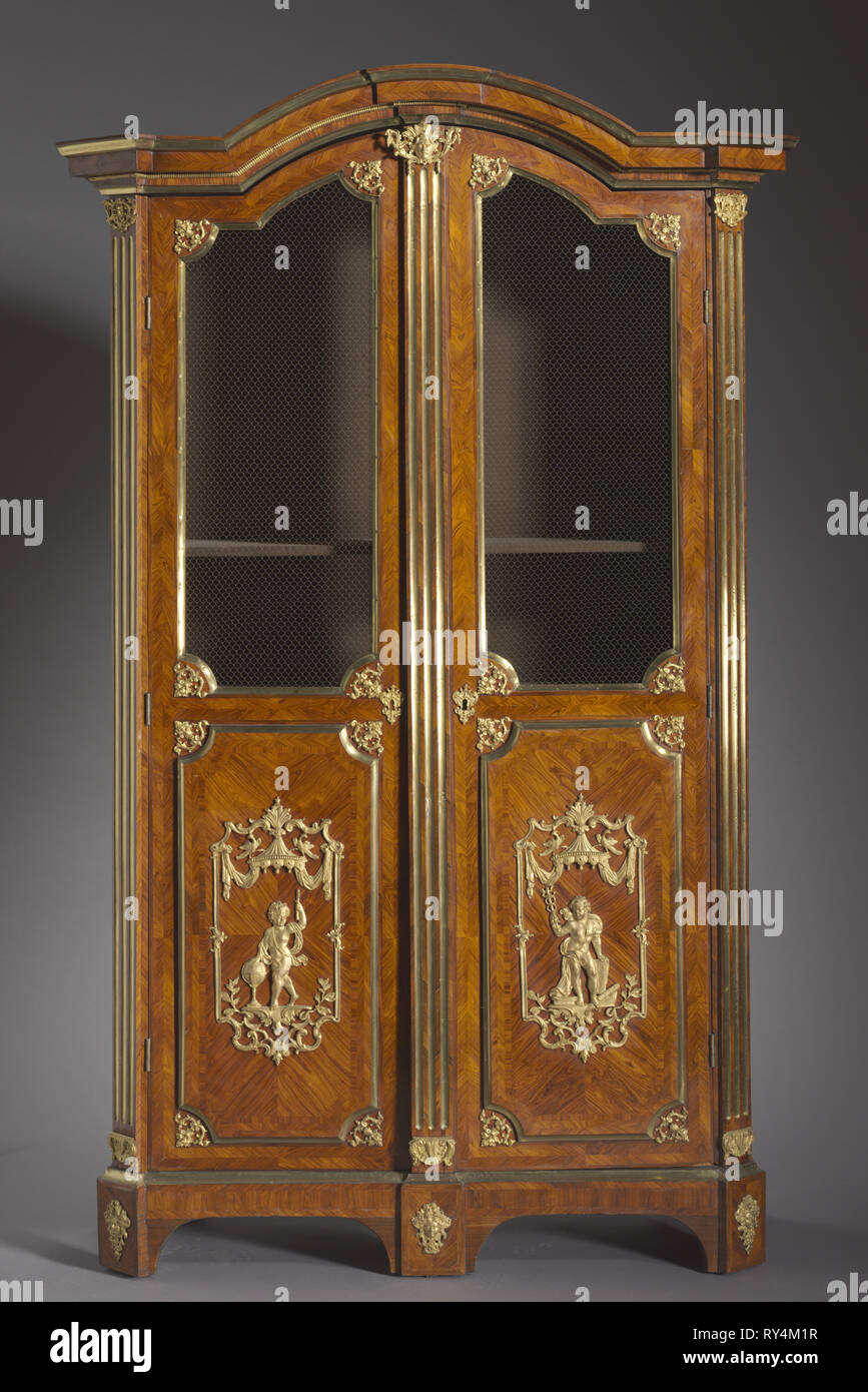 Bookcase , c. 1720. Attributed to Charles Cressent (French, 1685-1768). Kingwood and rosewood veneers, gilt metal mounts; overall: 247.6 x 132.1 x 57.2 cm (97 1/2 x 52 x 22 1/2 in - Stock Image