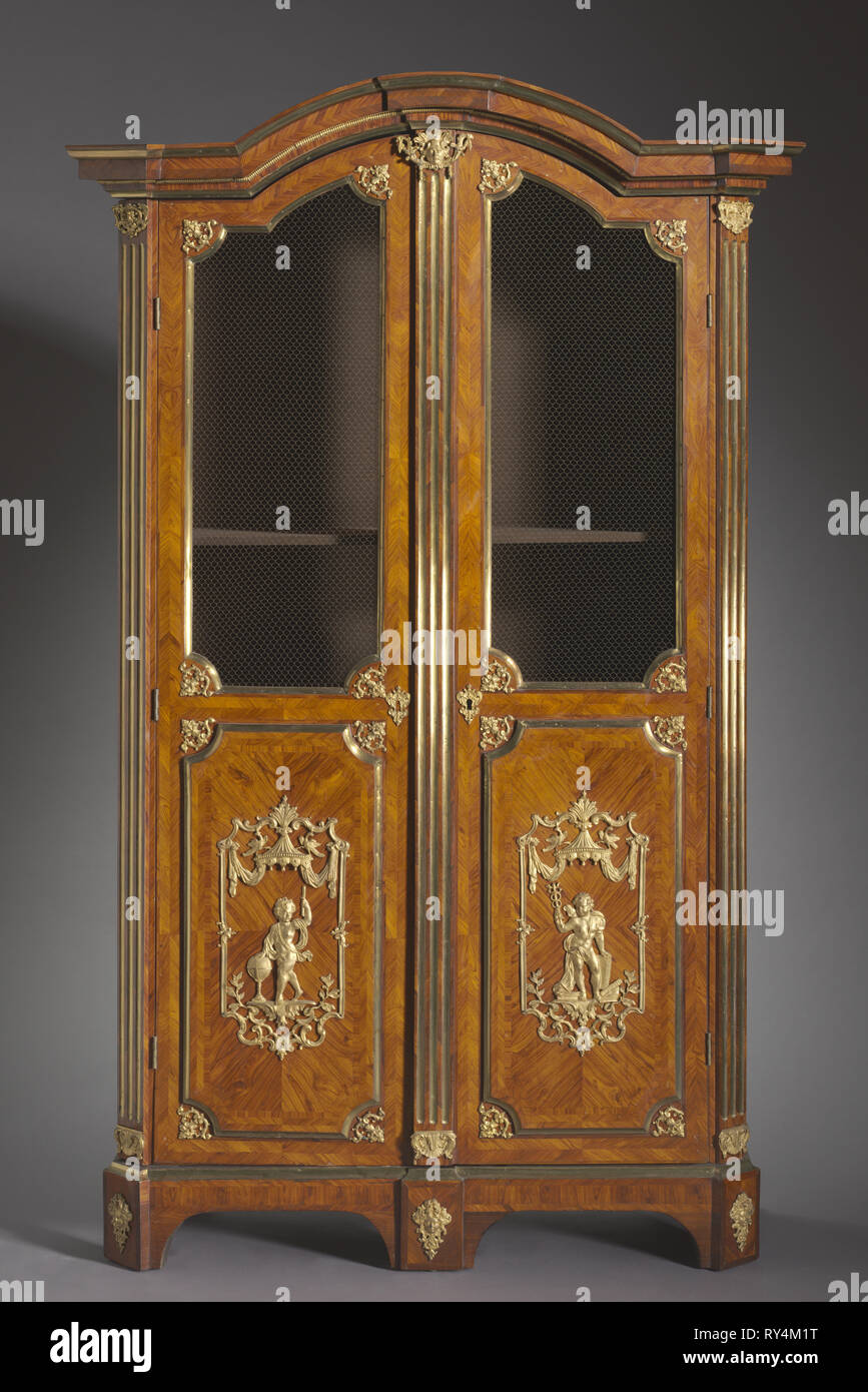 Bookcase, c. 1720. Attributed to Charles Cressent (French, 1685-1768). Kingwood and rosewood veneers, gilt metal mounts; overall: 247.6 x 132.1 x 57.2 cm (97 1/2 x 52 x 22 1/2 in - Stock Image