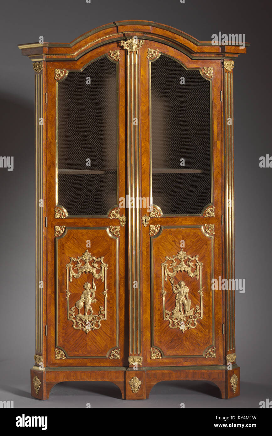 Pair of Bookcases (Bibliothèques), c. 1720. Attributed to Charles Cressent (French, 1685-1768). Kingwood and rosewood veneers, gilt metal mounts; overall: 247.6 x 132.1 x 57.2 cm (97 1/2 x 52 x 22 1/2 in - Stock Image