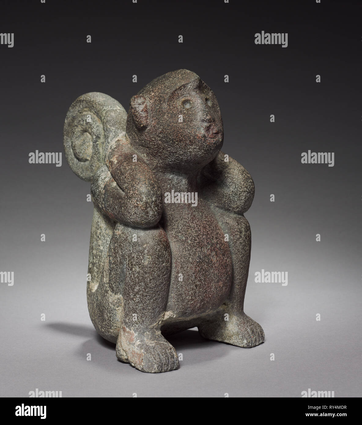 Monkey, 1325-1519. Central Mexico, Tacuba, Aztec, Post-Classic Period. Stone; overall: 24.5 x 14.5 x 20.5 cm (9 5/8 x 5 11/16 x 8 1/16 in - Stock Image