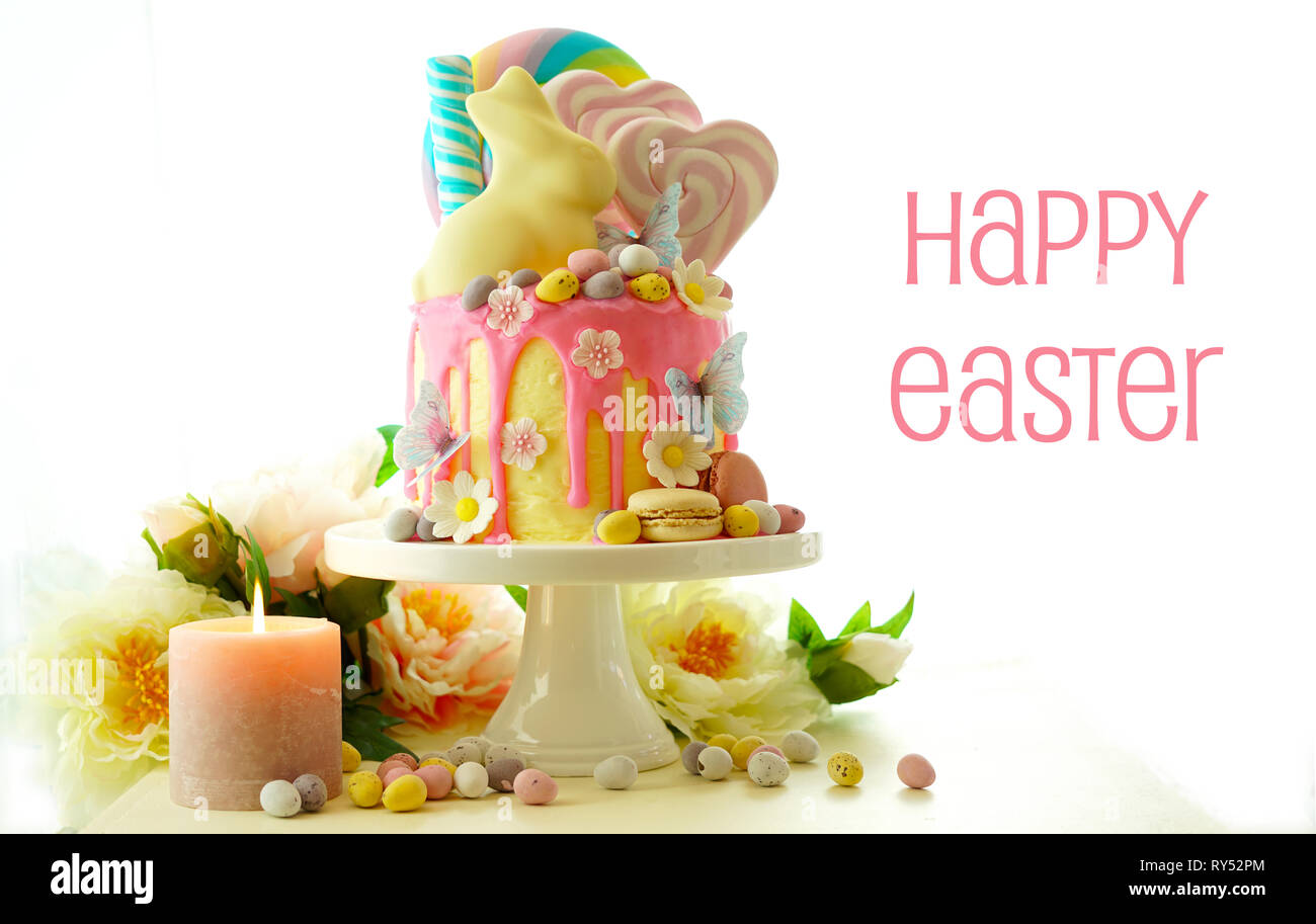 On trend Easter theme candy land drip cake decorated with