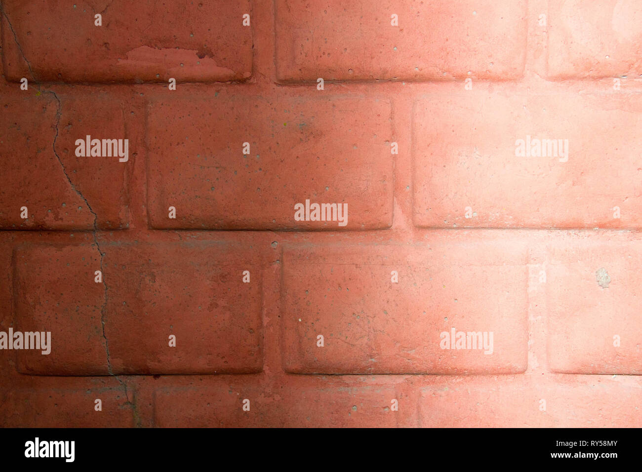 Photo wall brick wall. The texture of an old brick wall, shot under natural lighting. Wall beginning of the 20th century. - Stock Image