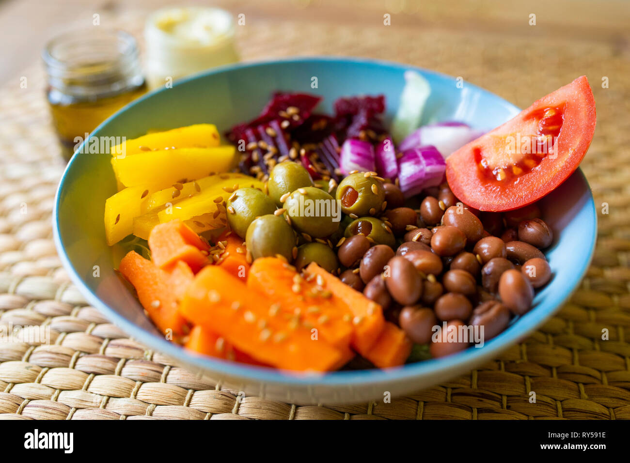 A vibrant vegan buddha bowl filled with colourful vegetables and pulses Stock Photo