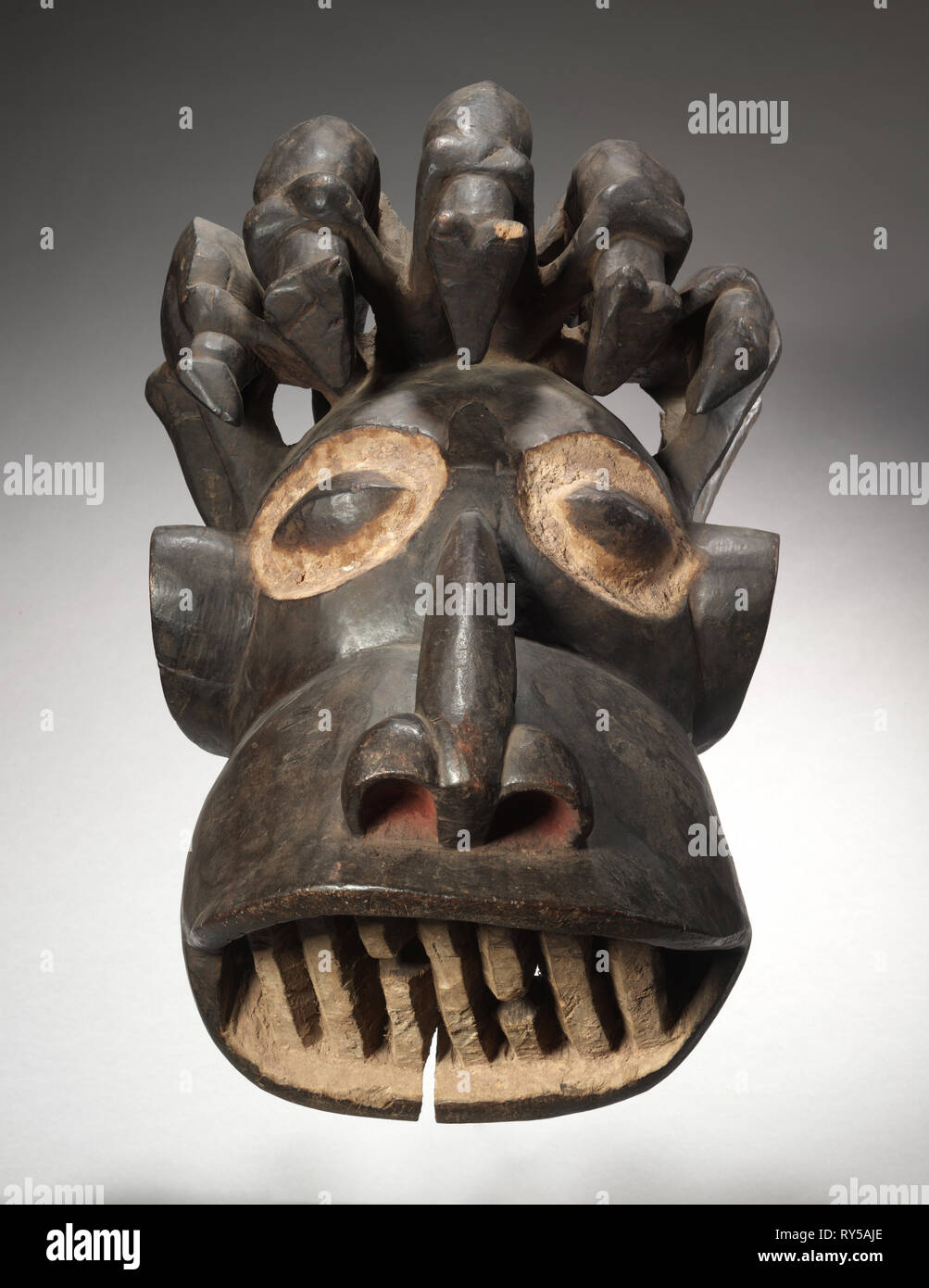 Helmet Mask, early 1900s. Equatorial Africa, Cameroon, possibly Kom, early 20th century. Wood, pigment; overall: 33 x 63.5 x 41.9 cm (13 x 25 x 16 1/2 in - Stock Image