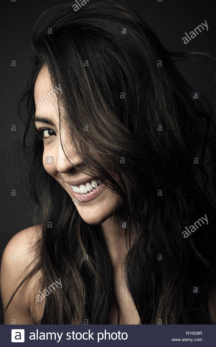 Portrait confident beautiful Latina woman with long black hair - Stock Image