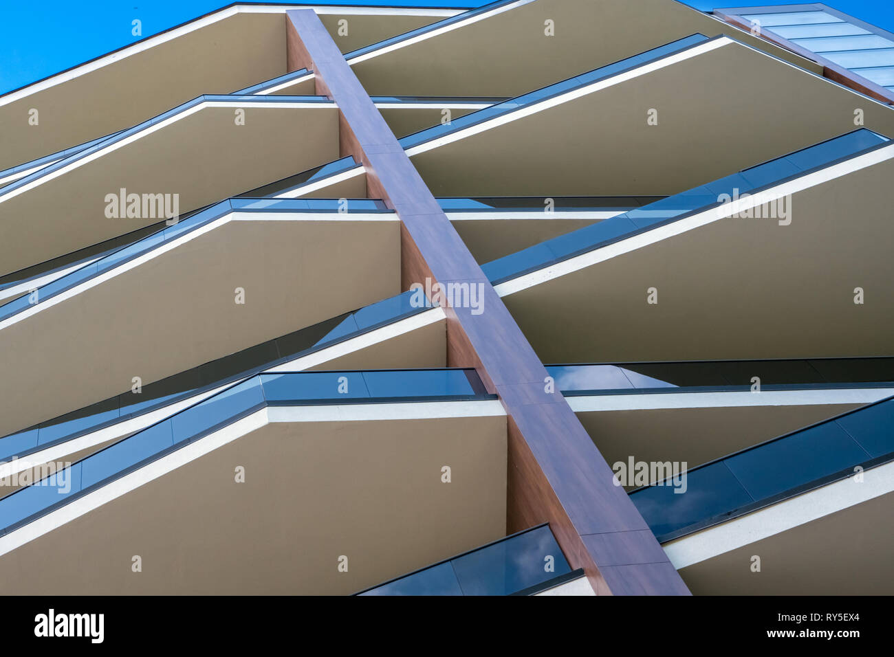 Modern building. Modern office building with facade of glass. Modern highrise skyscraper steel and glass architecture. Office building exterior Stock Photo