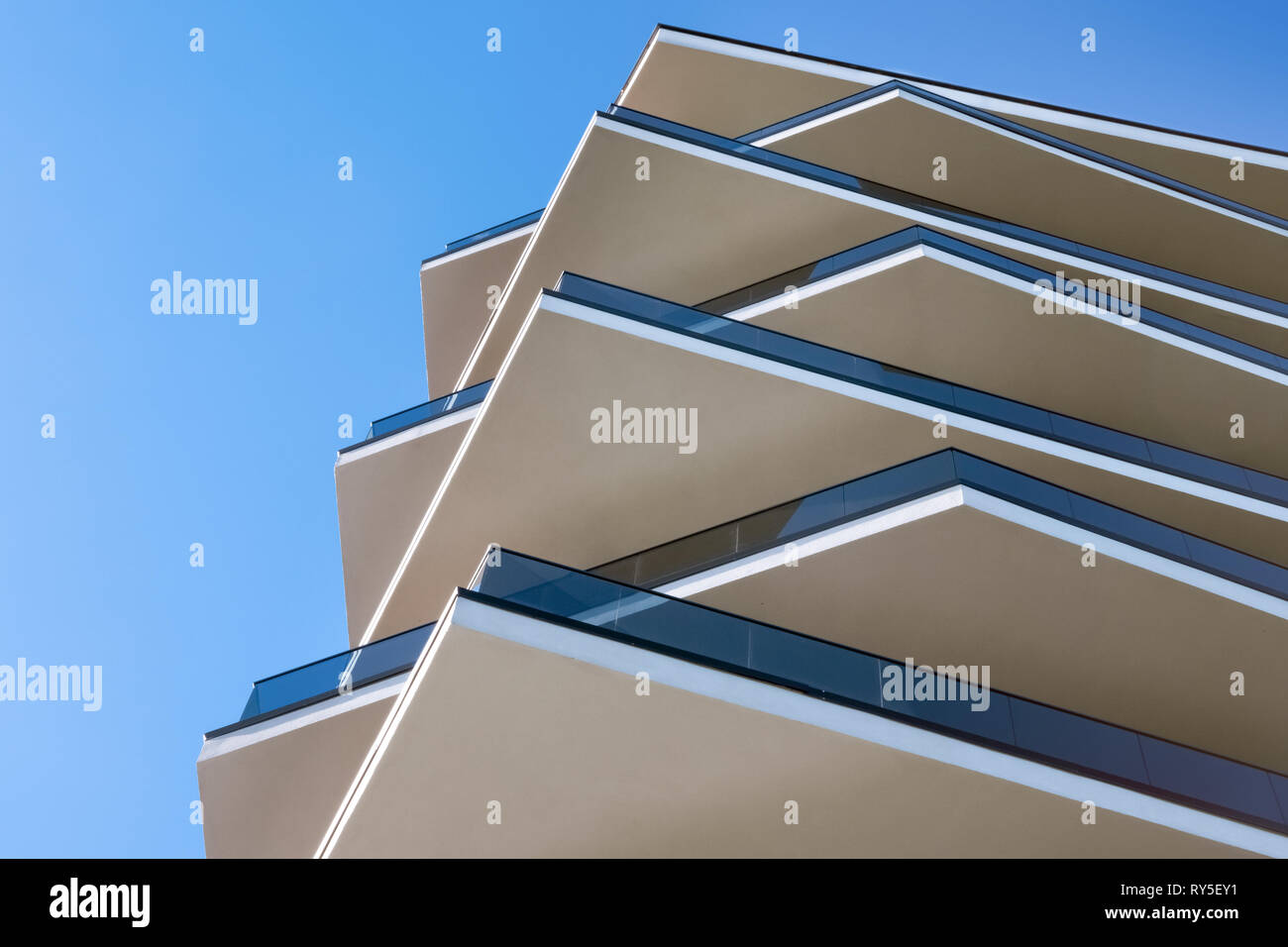 Modern building. Modern office building with facade of glass. Modern highrise skyscraper steel and glass architecture. Office building exterior. Stock Photo