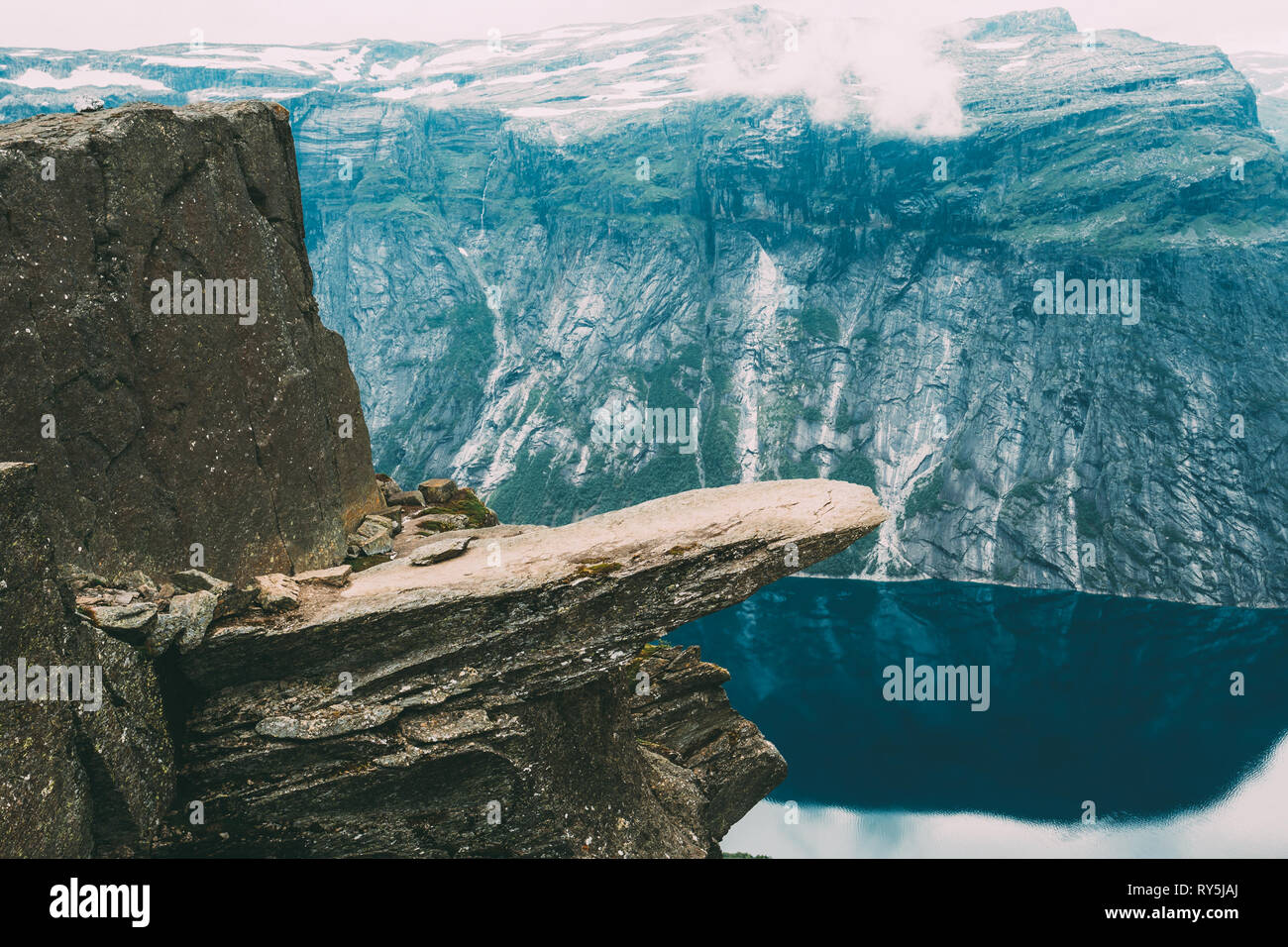 Scenic View Of Rock Trolltunga - Troll Tongue In Norway. Rock In The Mountains Of Norway - Stock Image