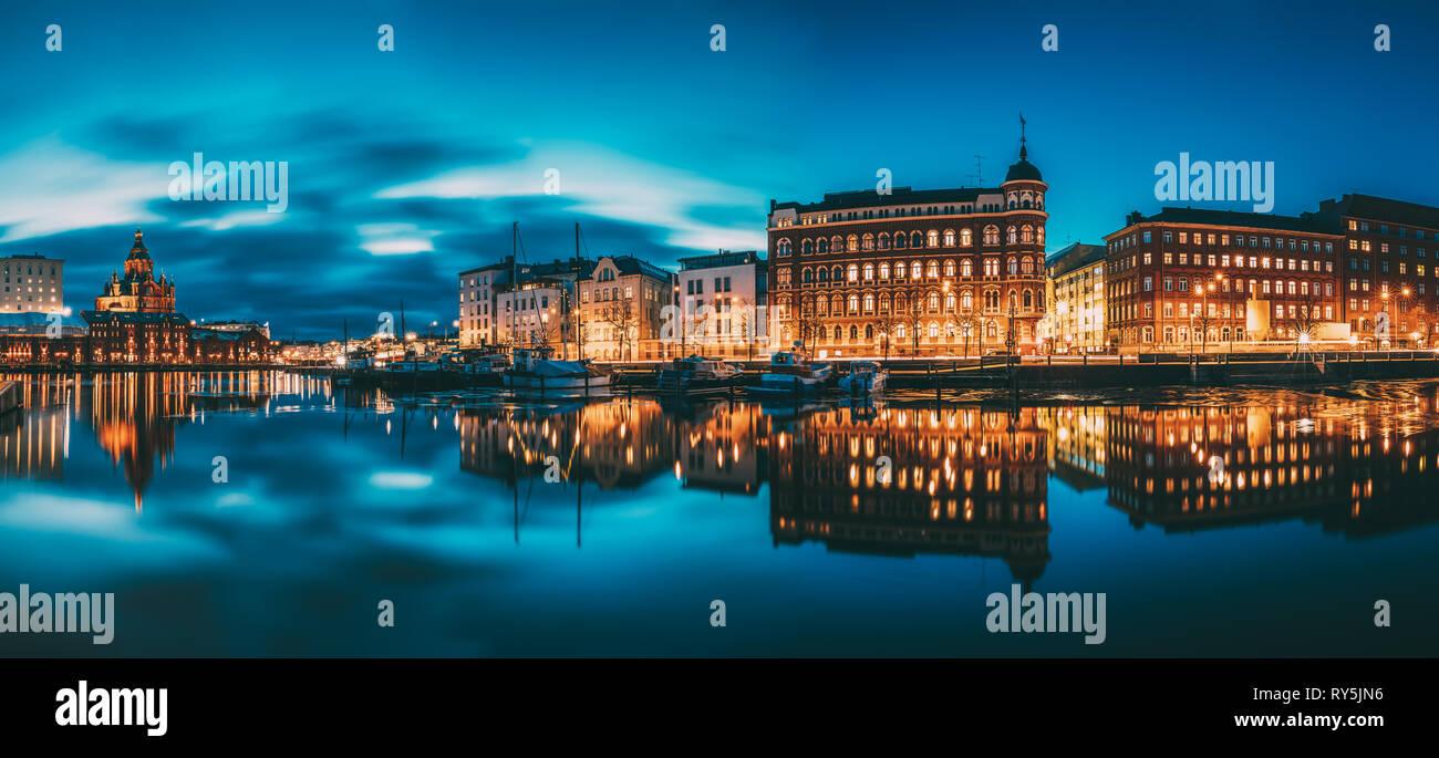 Helsinki, Finland. Panoramic View Of Kanavaranta Street With Uspenski Cathedral And Pohjoisranta Street In Evening Night Illuminations Stock Photo