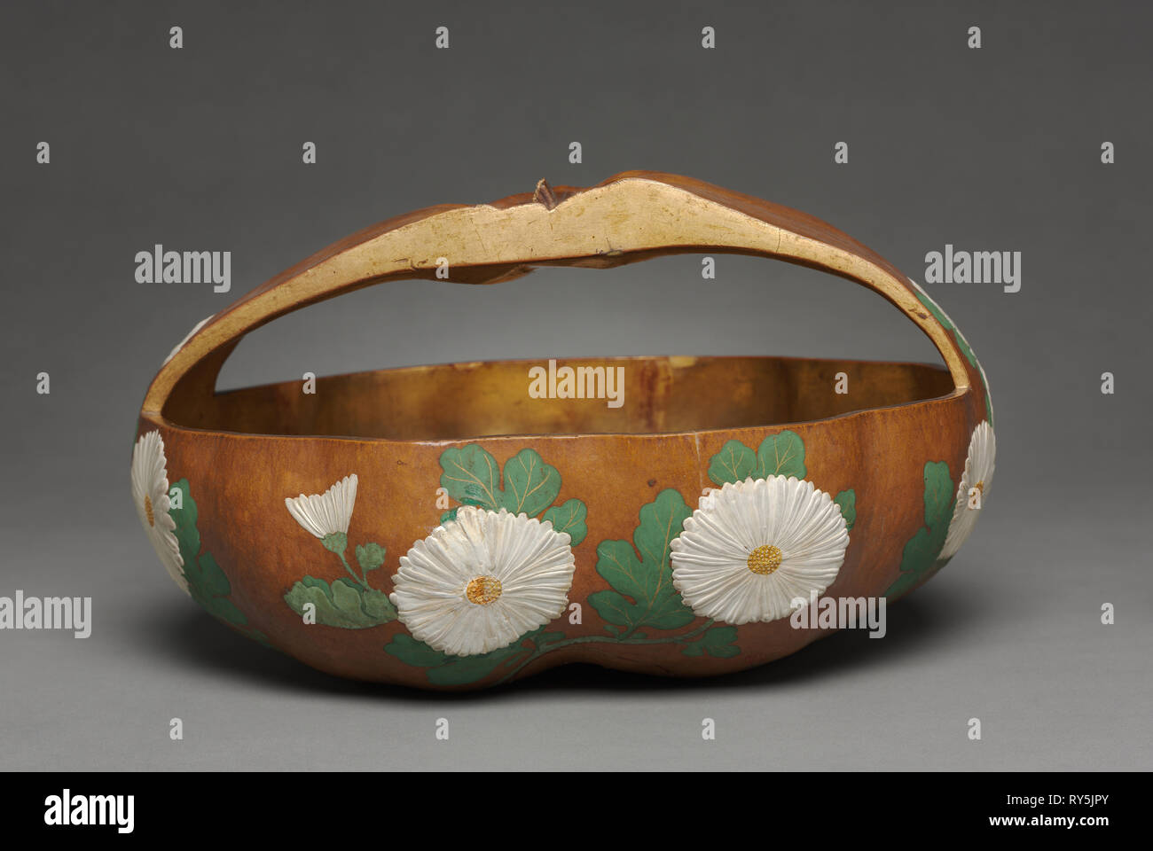 Gourd Basket with Chrysanthemum Design, 1700s. Attributed to Ogata Korin (Japanese, 1658-1716). Gourd; lacquered and painted with gesso, color, and gold pigments; overall: 16 x 30.2 cm (6 5/16 x 11 7/8 in - Stock Image