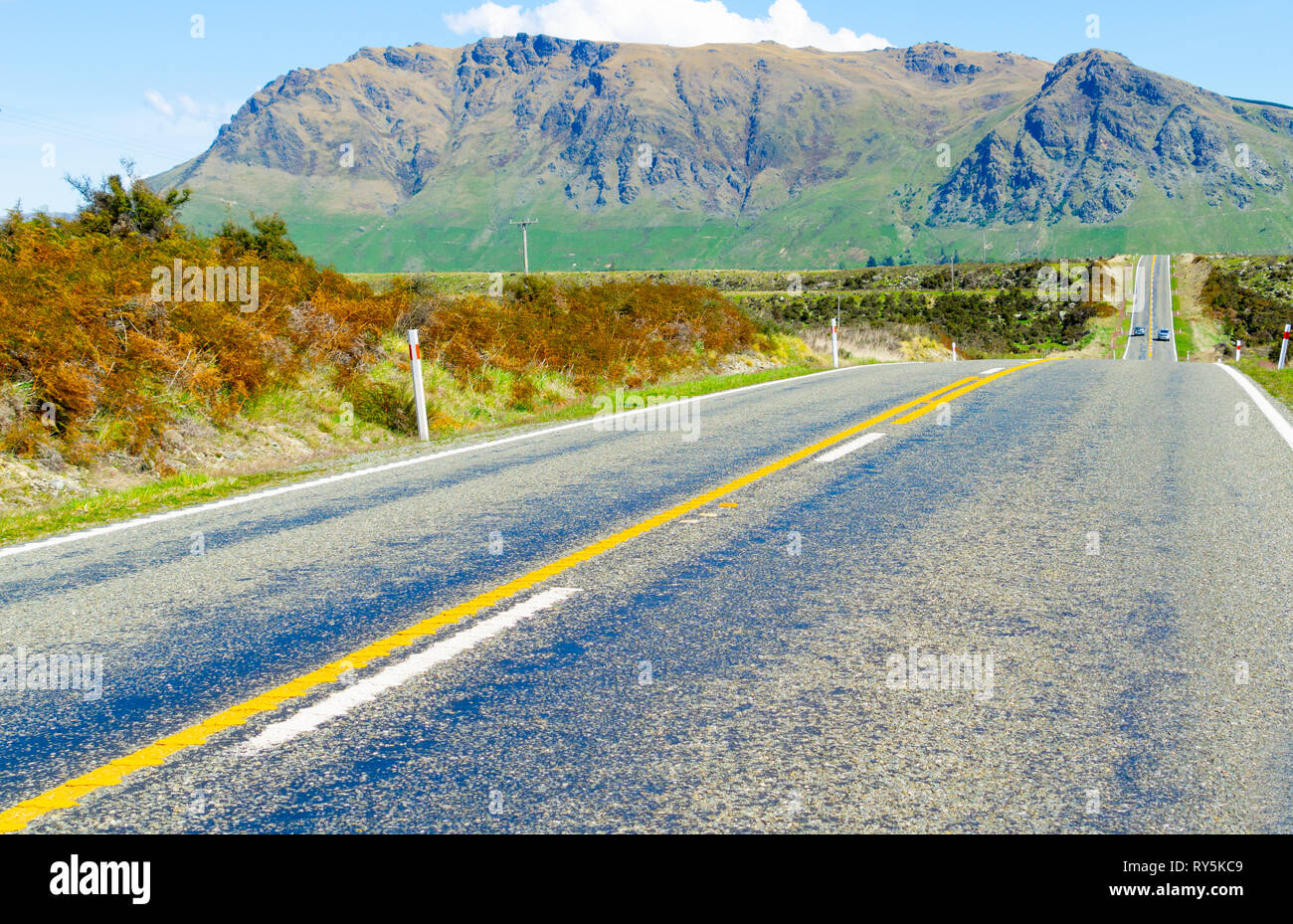 South Island highway with yellow no over-taking line. - Stock Image