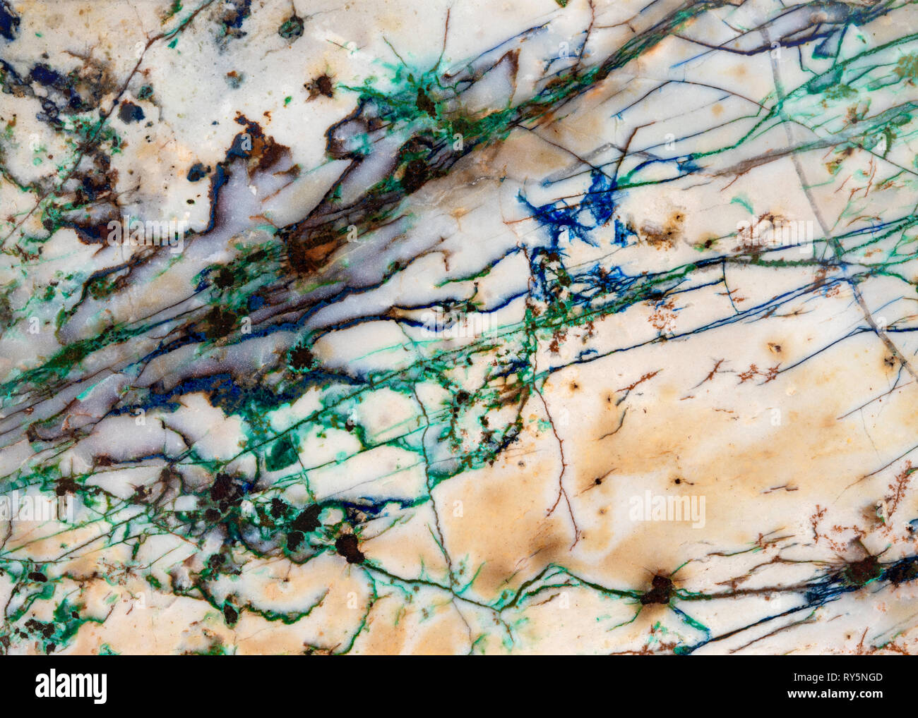 Detail of mineral veins running thru a slice of rock. The blue and green are Azurite and Malachite respectively. - Stock Image