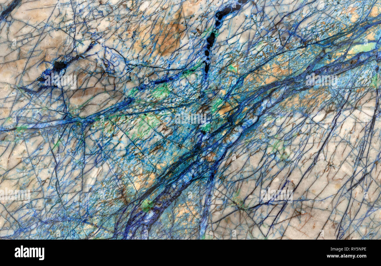 Rivers on another planet, detail of mineral veins running thru a slice of rock. The blue and green are Azurite and Malachite respectively. - Stock Image