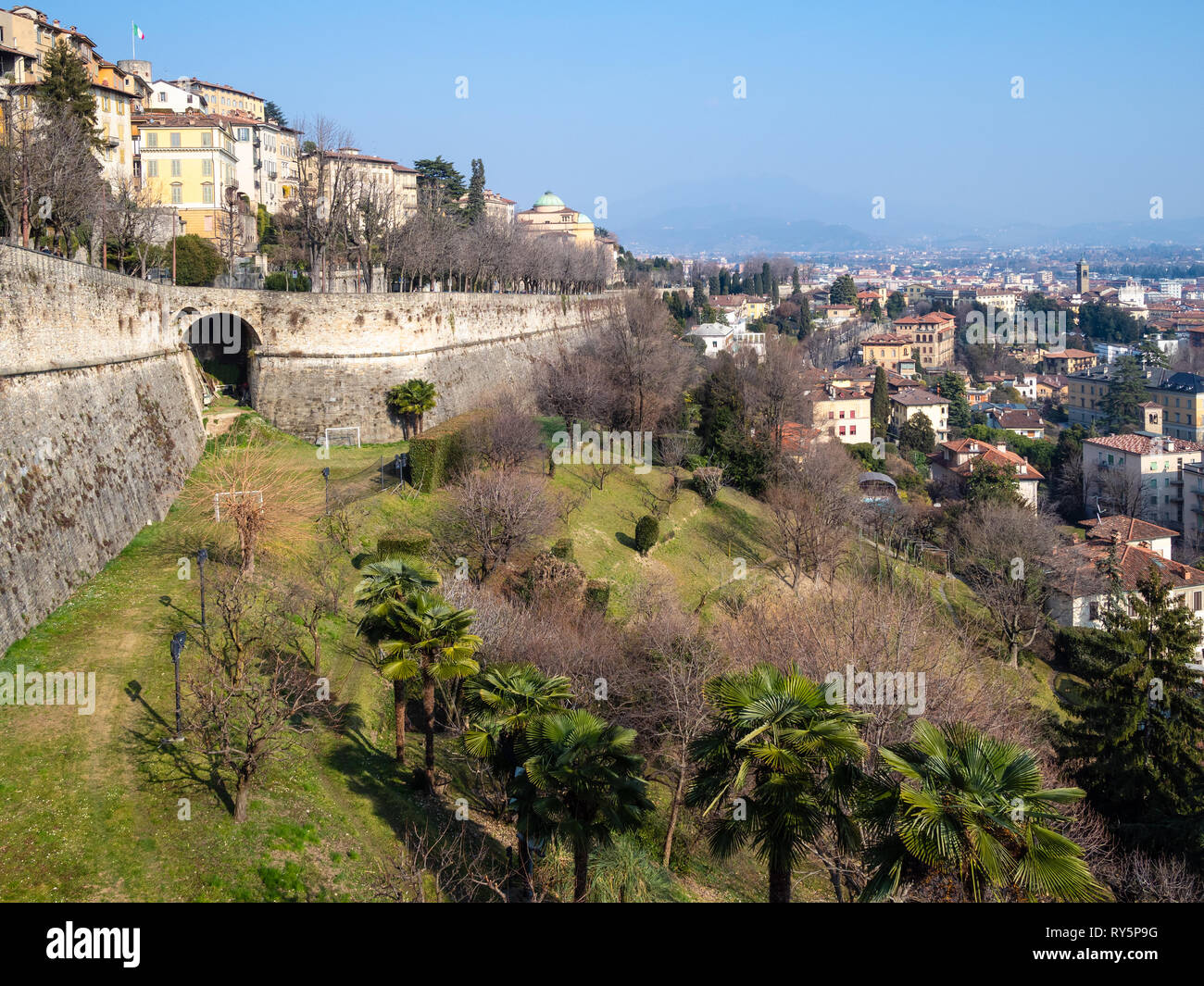 Travel to Italy - street viale delle Mura over Sant Andrea platform of Venetian Walls and view of Lower Town (Citta Bassa) from Porta San Giacomo gate Stock Photo