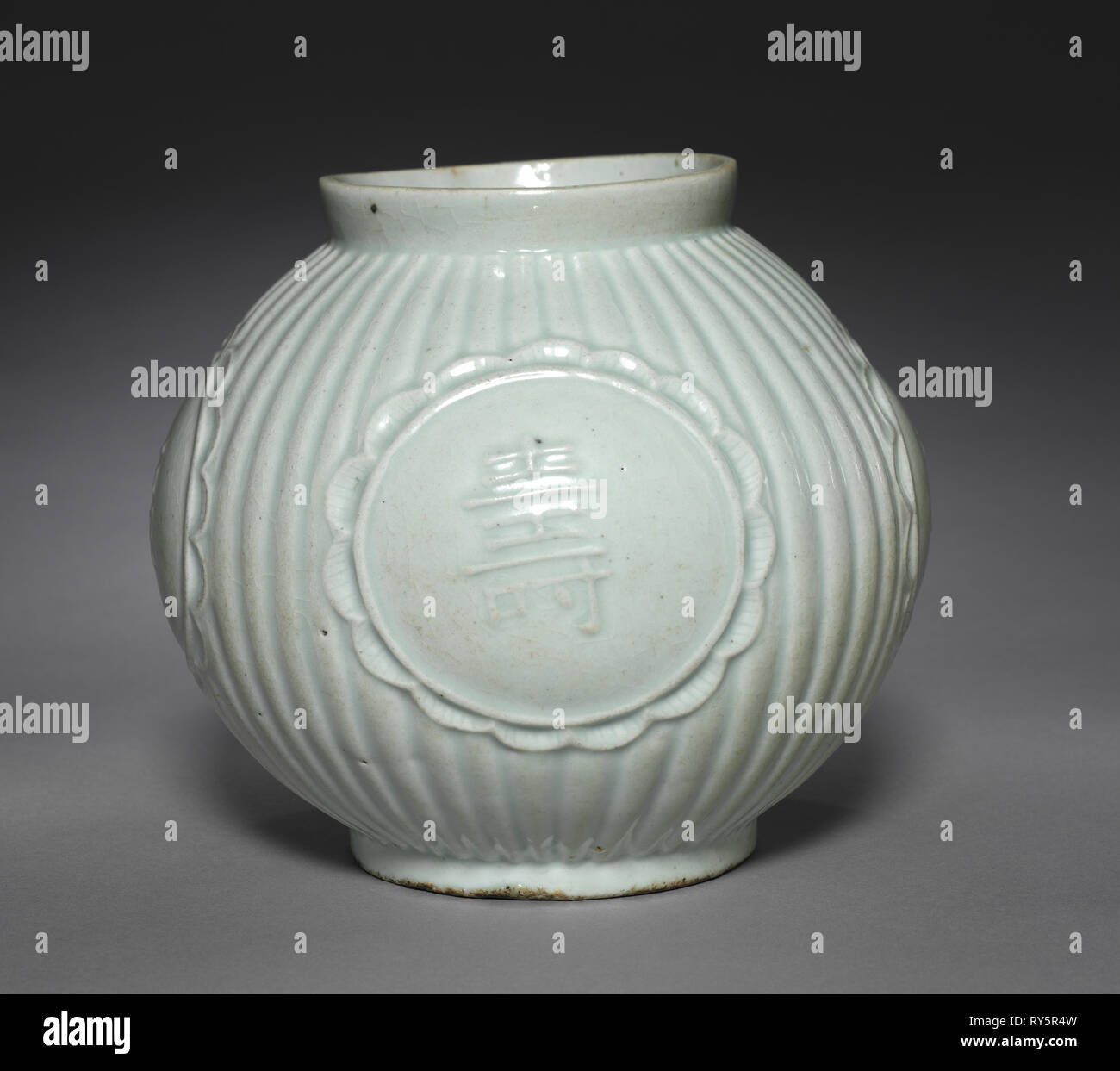 Jar with Four Auspicious Characters in Relief, 1800s. Korea, Joseon dynasty (1392-1910). Glazed porcelain - Stock Image