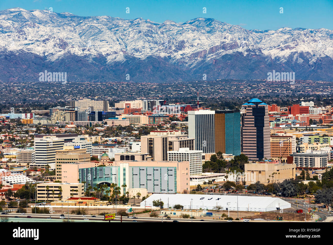 view of downtown Tucson, Arizona in winter, snow on the Santa Catalina Mountians in the distance. - Stock Image