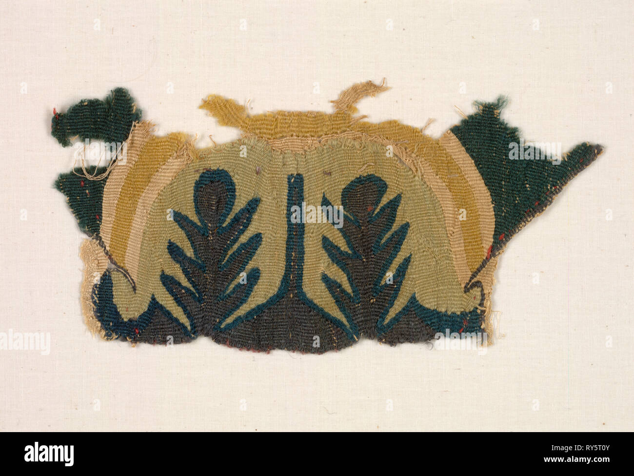 Fragment with Abstracted Leaves, 500s. Egypt, Byzantine period, 6th century. Tabby weave with inwoven tapestry ornament, linen and wool; overall: 22.3 x 10.2 cm (8 3/4 x 4 in - Stock Image