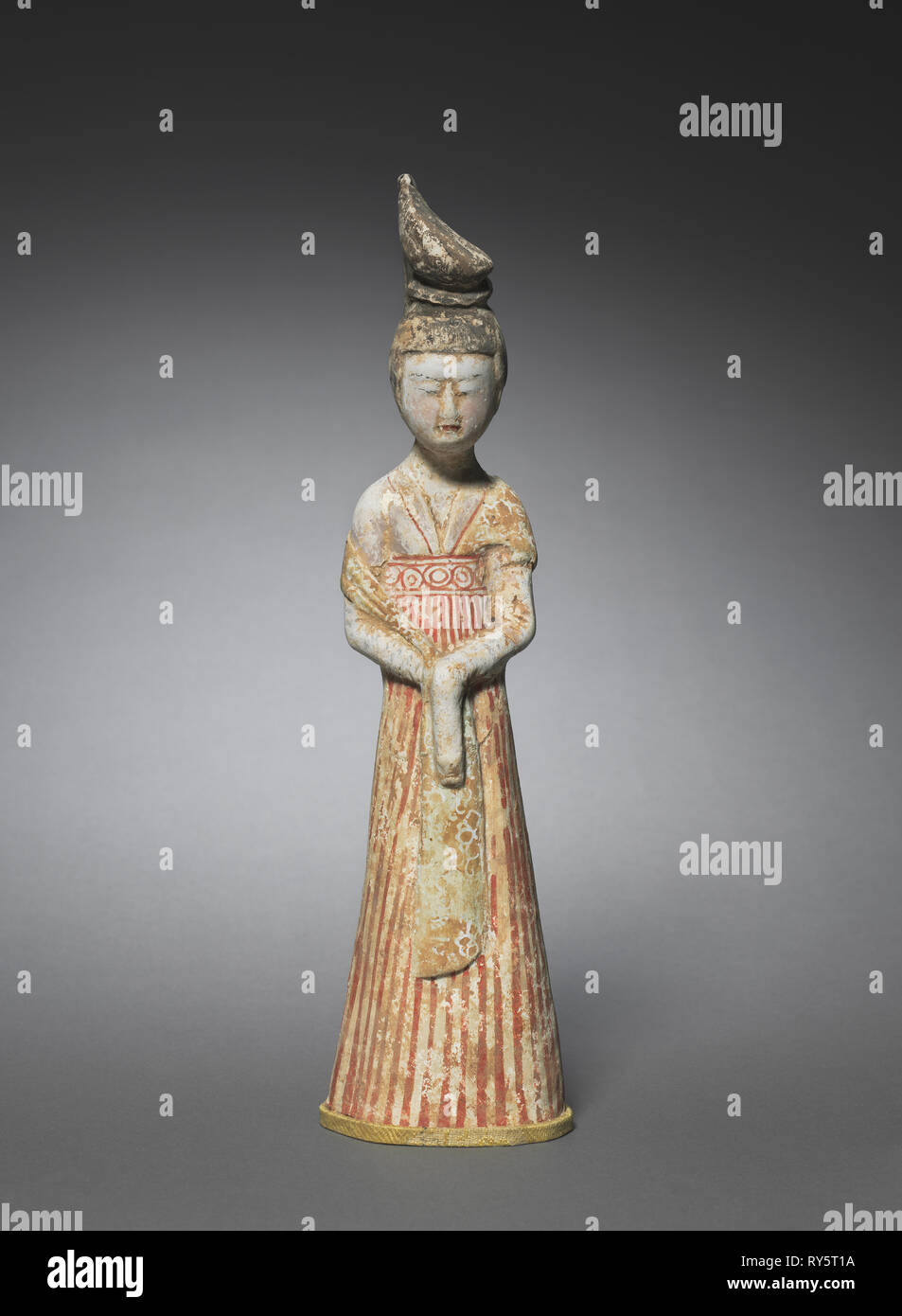Court Lady with High Chignon, c. 700-750. North China, Tang dynasty (618-907). Earthenware with polychromy; overall: 31.6 cm (12 7/16 in - Stock Image