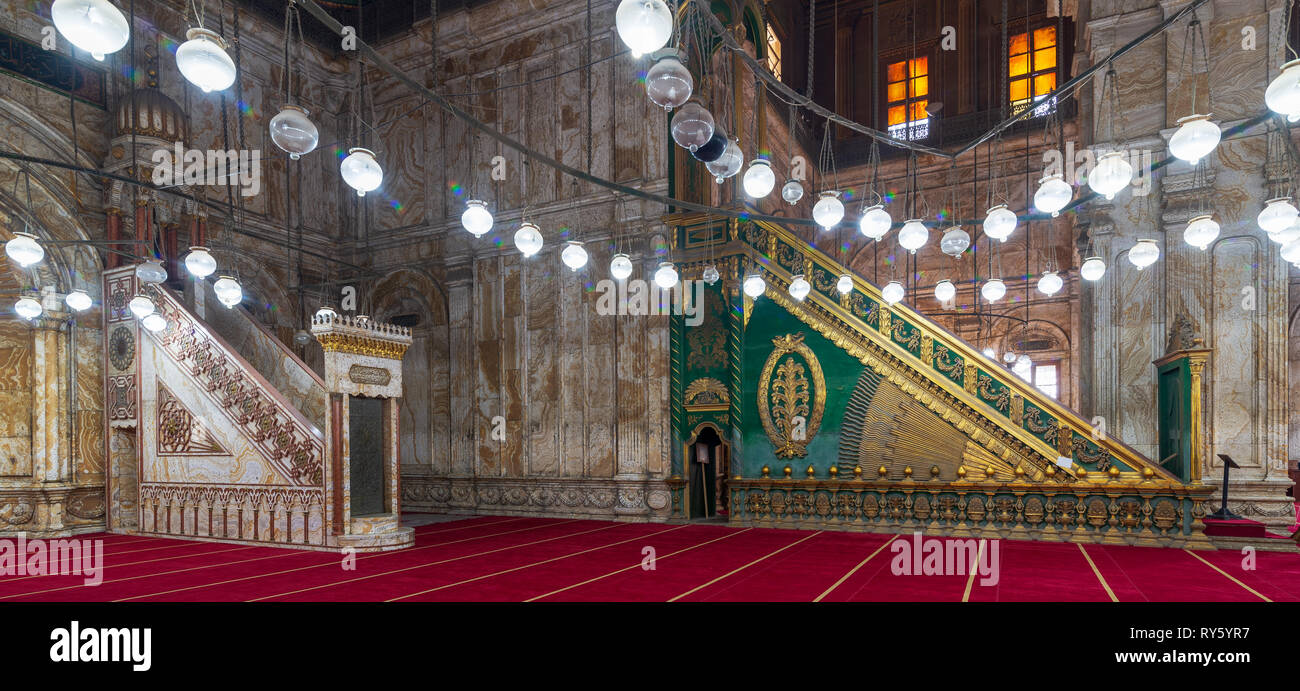 Engraved marble alabaster platform (Minbar) and wooden green decorated platform at the great Mosque of Muhammad Ali Pasha (Alabaster Mosque), situated - Stock Image