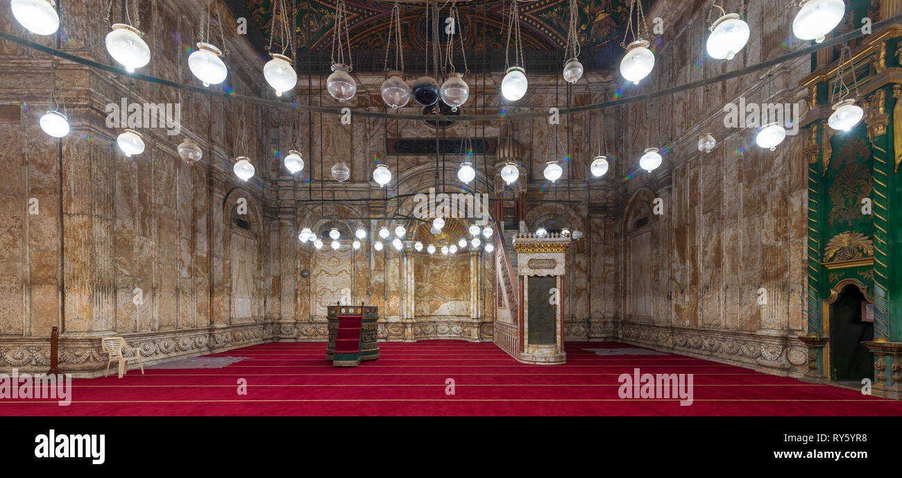 Decorated alabaster (marble) wall with engraved niche (Mihrab) and Platform (Minbar) at the great Mosque of Muhammad Ali Pasha (Alabaster Mosque), sit - Stock Image