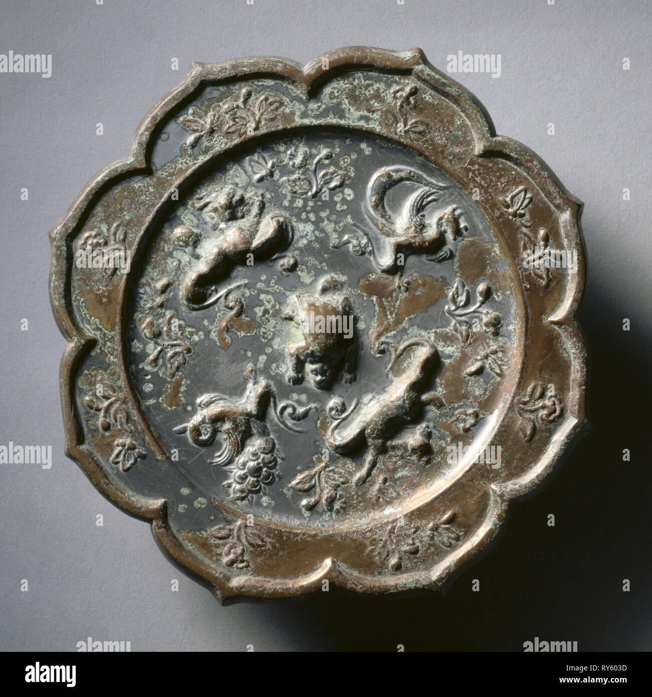 Octafoil Mirror with Crouched Animals, early 7th Century - early 10th Century Stock Photo