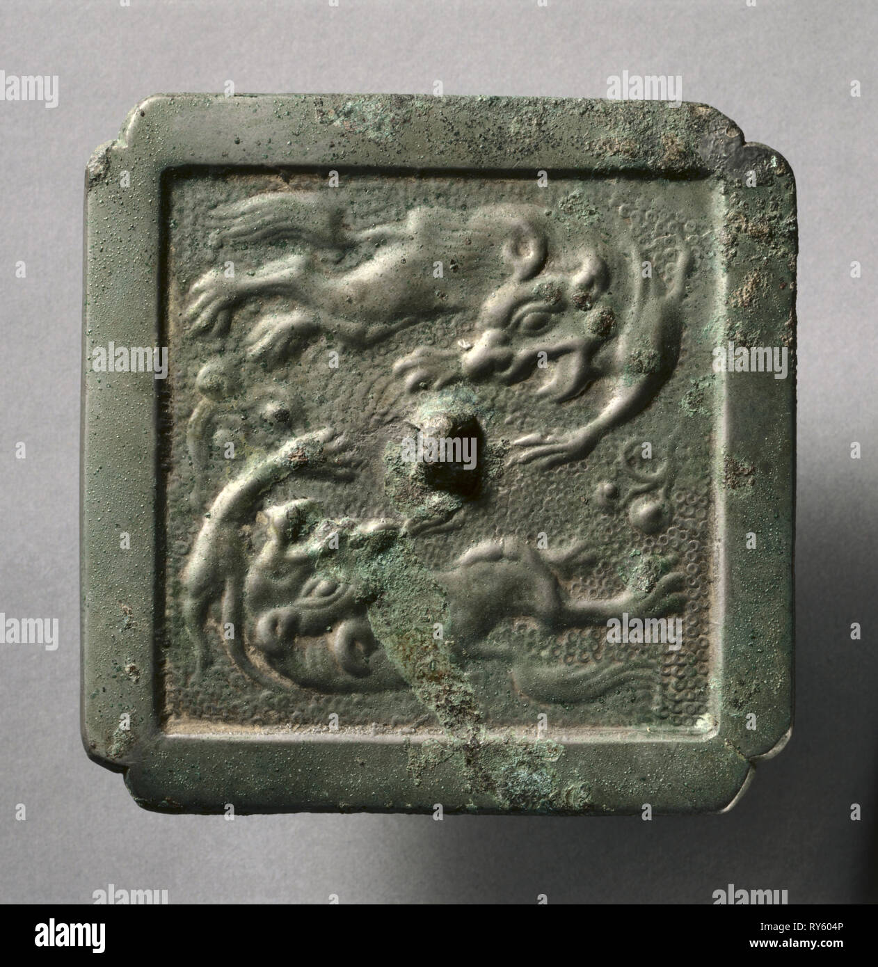 Cruciform Mirror with Two Lions, late 8th-early 9th century. China, Tang dynasty (618-907). Bronze; overall: 0.7 x 10.5 cm (1/4 x 4 1/8 in.); rim: 0.4 cm (3/16 in - Stock Image