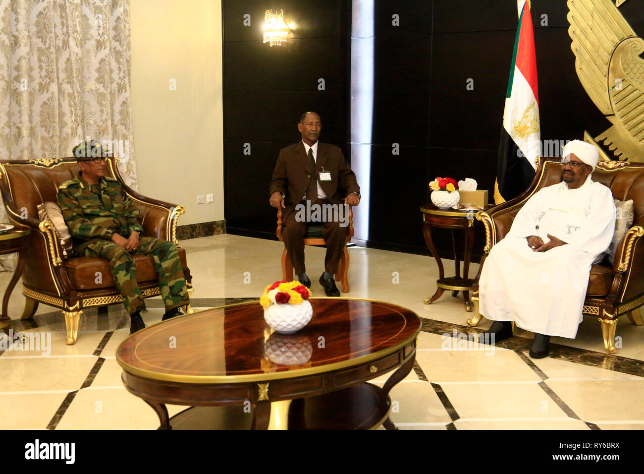 Khartoum, Sudan. 12th Mar, 2019. Sudanese President Omar al-Bashir (R) meets with Seare Mekonen (L), Ethiopian army's chief of staff, in Khartoum, Sudan, on March 12, 2019. Sudan and Ethiopia on Tuesday signed a protocol in Khartoum to deploy joint forces on the border between them. Credit: Mohamed Khidir/Xinhua/Alamy Live News - Stock Image