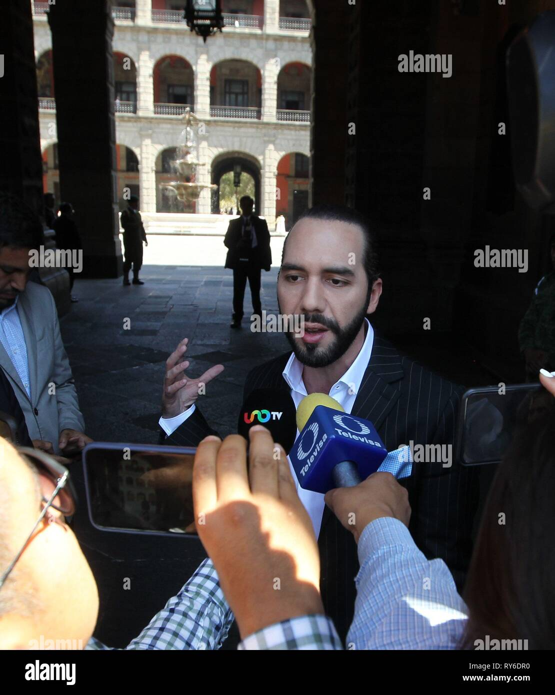 Salvadoran President-elect Nayib Bukele (C) arrives for a meeting with Mexican President Andres Manuel Lopez Obrador, at the National Palace, in Mexico City, Mexico, 12 March 2019. EFE/ Mario Guzman - Stock Image