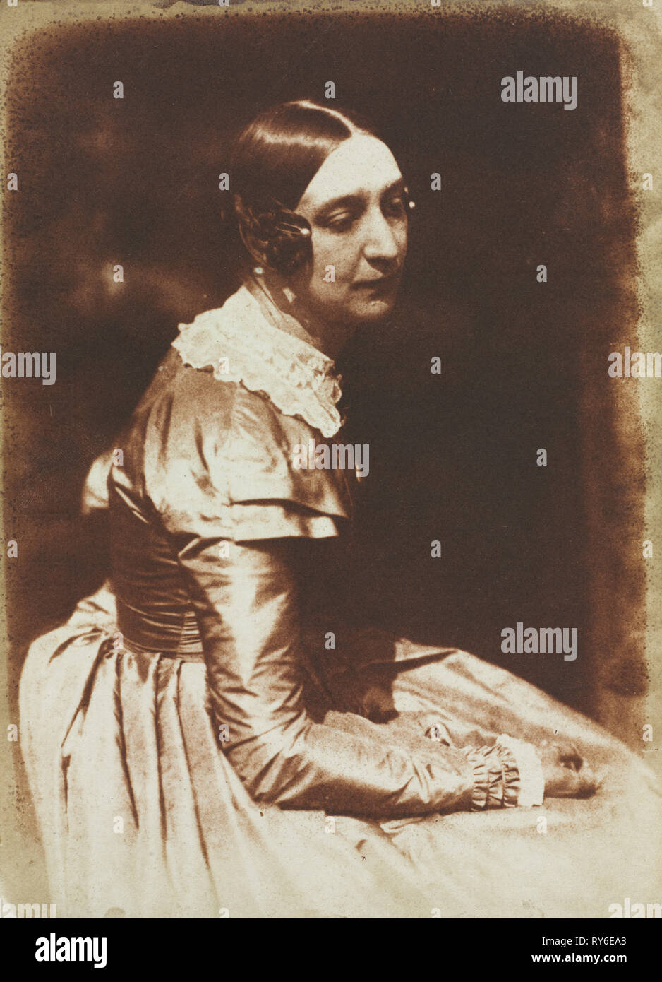 Elizabeth Rigby, later Lady Eastlake (1809-1893), c. 1844-1845. David Octavius Hill (British, 1802-1870), and Robert Adamson (British, 1821-1848). Salted paper print from calotype negative; image: 21.5 x 15.6 cm (8 7/16 x 6 1/8 in.); matted: 45.7 x 35.6 cm (18 x 14 in - Stock Image