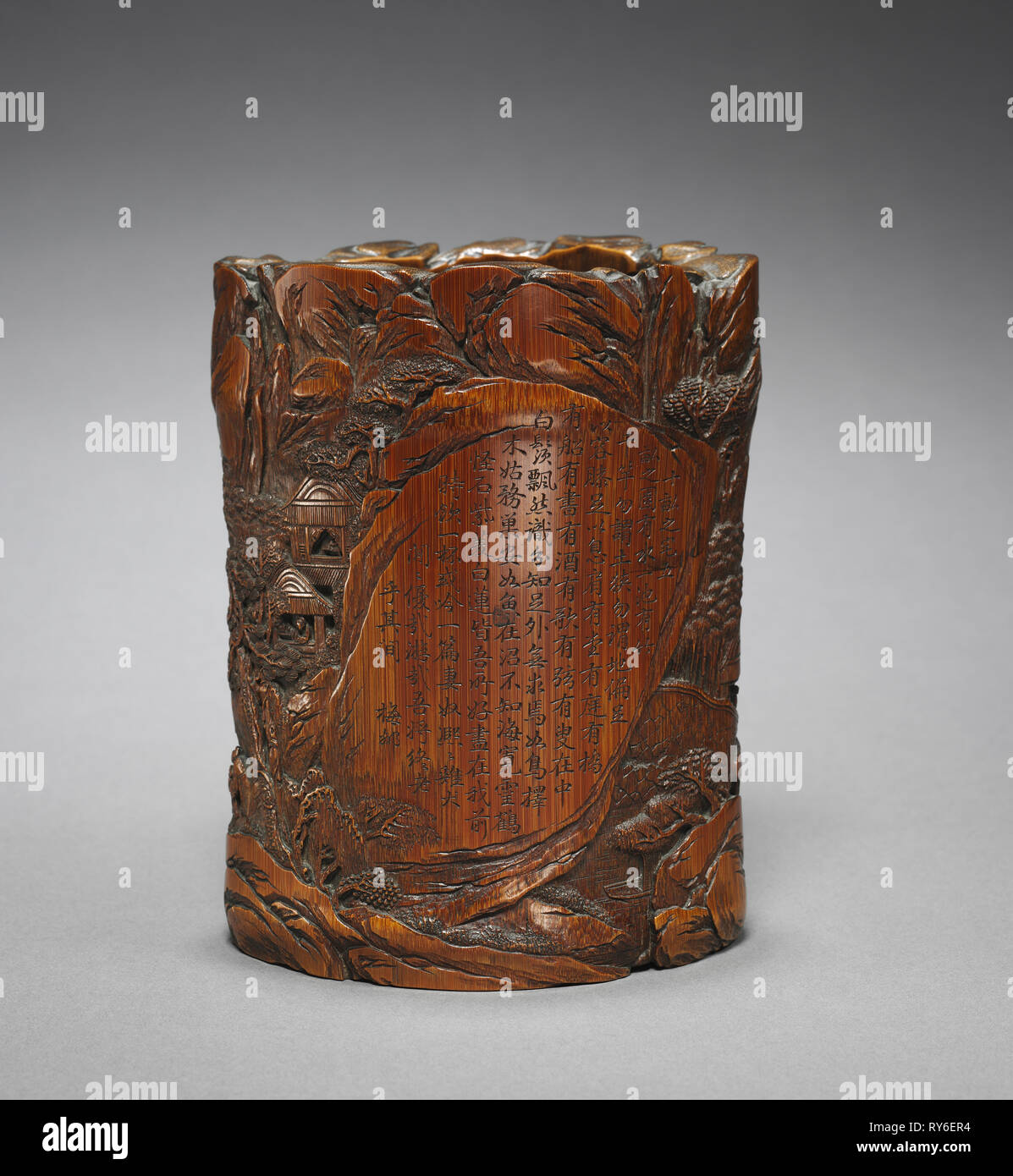 Brush Holder with Figures in Landscape and Poetic Inscription, 1700s. China, Qing dynasty (1644-1911). Carved bamboo; overall: 16 x 12.4 cm (6 5/16 x 4 7/8 in - Stock Image
