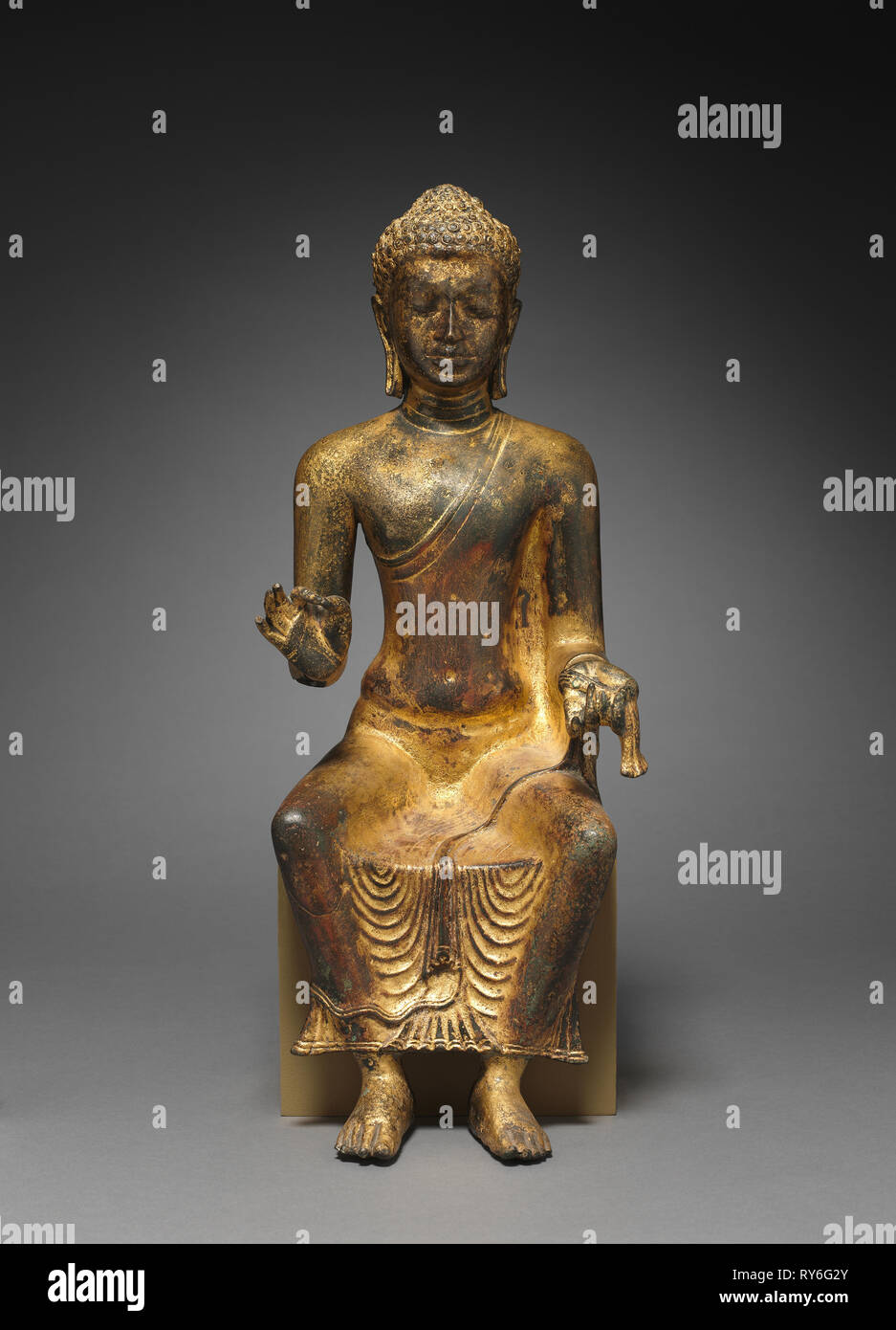 Enthroned Buddha preaching, 700s-800s. Myanmar or Thailand, 8th-9th century. Copper alloy with gilding - Stock Image