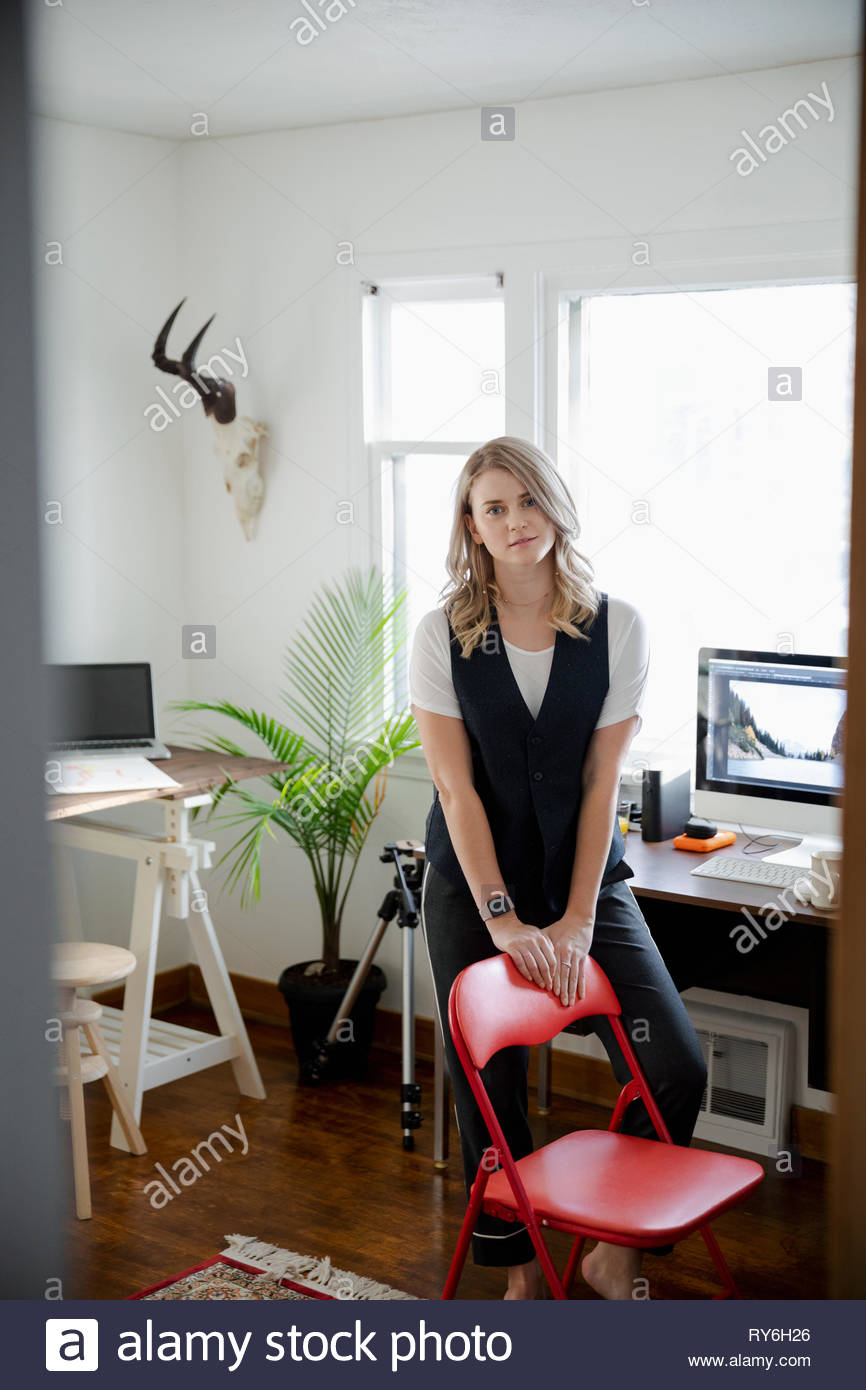 Portrait confident woman working in home office - Stock Image