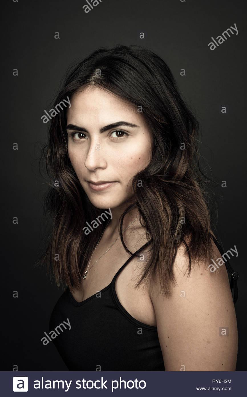 Portrait confident beautiful young brunette Latina woman - Stock Image