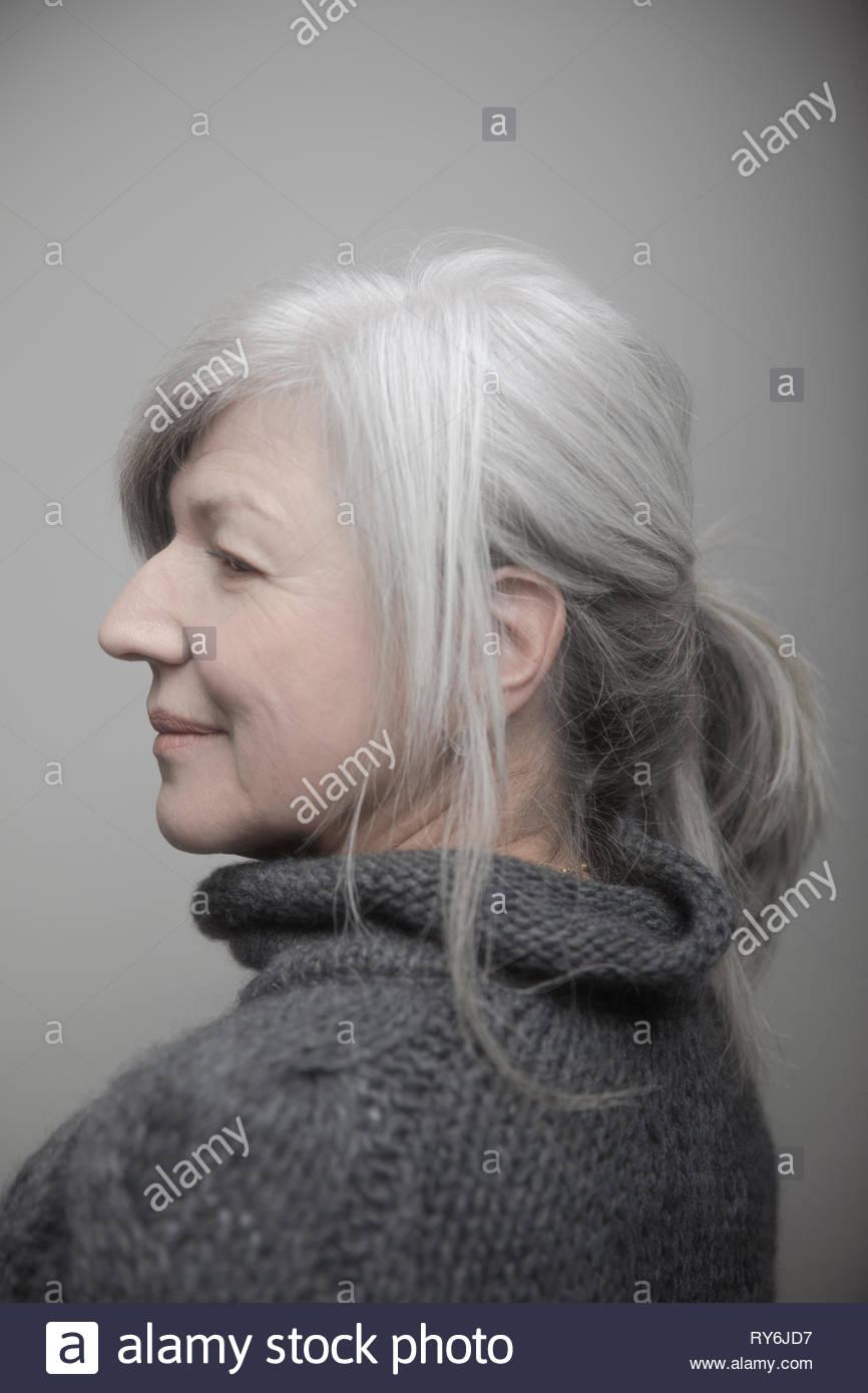 Profile portrait beautiful senior woman with gray hair - Stock Image