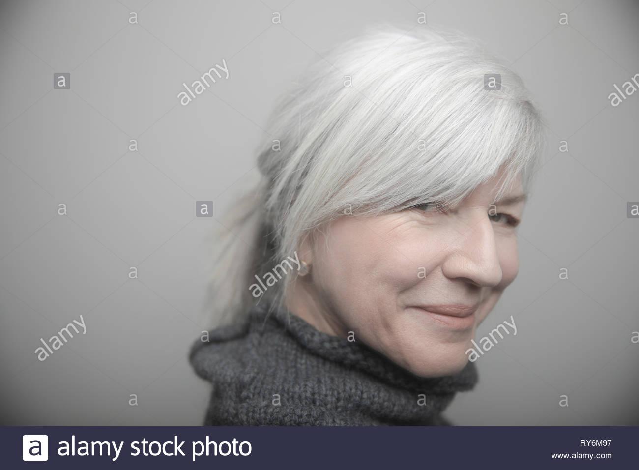 Portrait confident beautiful senior woman with gray hair - Stock Image