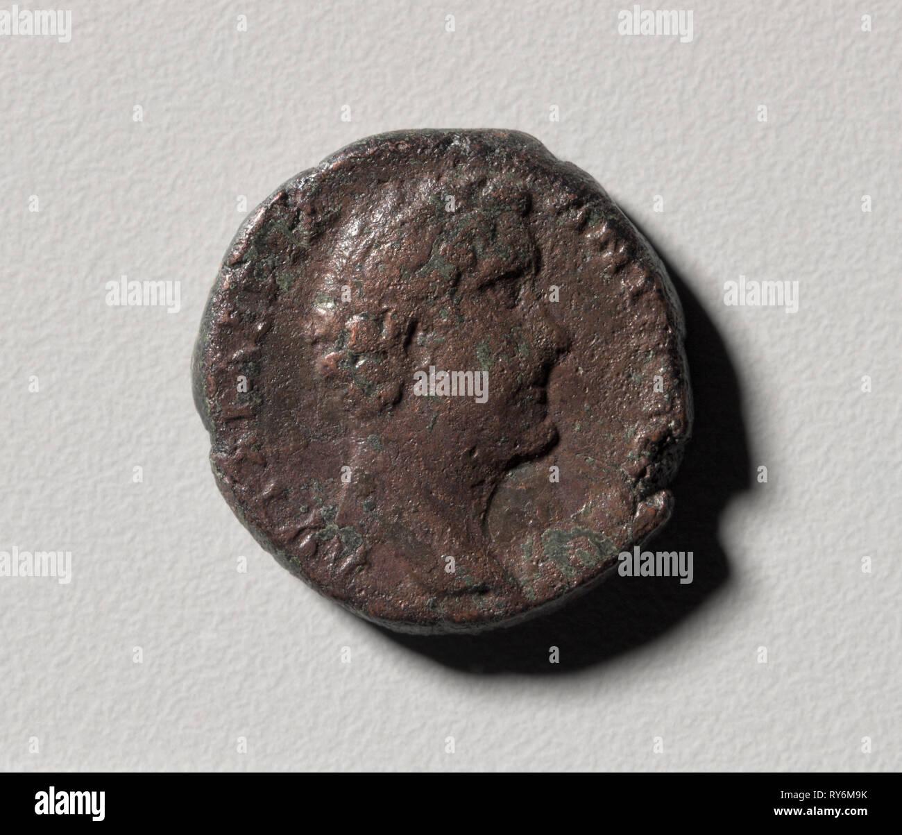 Profile Head of Antoninus Pius of Nicopolis (Nikopolis) ad Istrum (obverse) Apollo Sauroktonos (reverse), 138-161. Moesia Inferior, near modern Veliko Tarnovo Bulgaria, 2nd century. Bronze; diameter: 2.5 cm (1 in - Stock Image