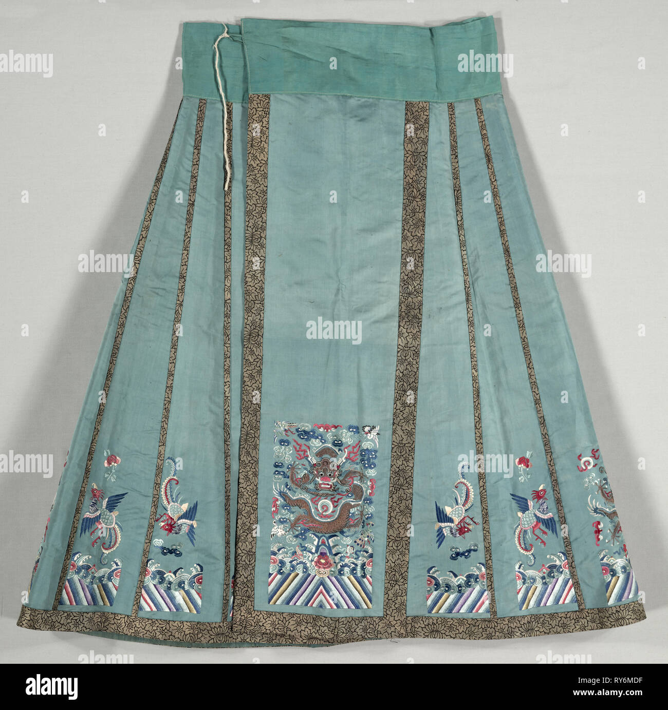 Woman's Bridal Dress, Pleated Skirt, 1800s. China, Qing Dynasty, late 19th century. Embroidery: silk, gilt-metal thread; overall: 94.6 x 86.4 cm (37 1/4 x 34 in - Stock Image