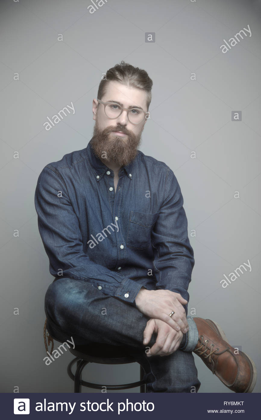 Portrait confident handsome young hipster man - Stock Image