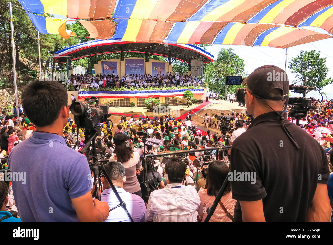 Camera men and audience at 74th Bataan Day Anniversary - Mount Samat, Philippines - Stock Image