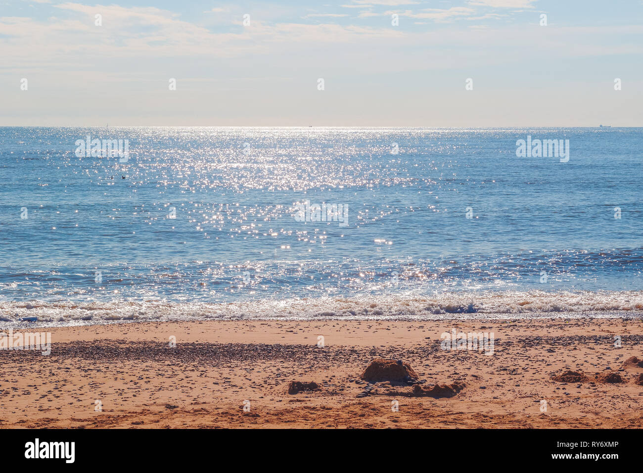 Sunlight reflecting on sparkling blue sea at Southwold beach, a popular seaside town of the UK - Stock Image